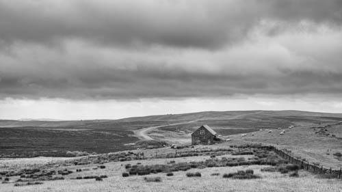 Moorland barn and winding road