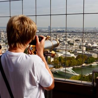 Views through telescope top of Eiffel Tower