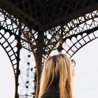 Sarah at foot of Eiffel Tower