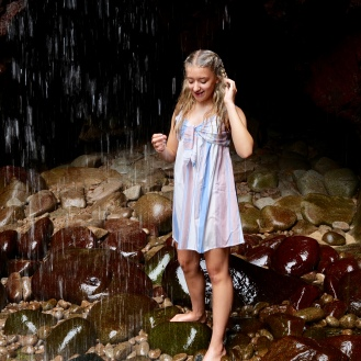 Sarah under the Plemont cave waterfall