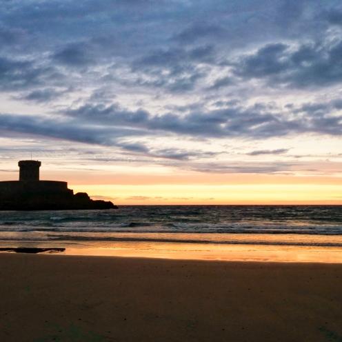 Sunset over St Oeuns Bay