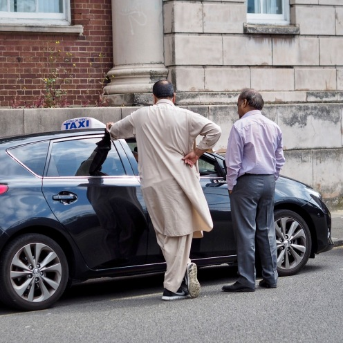 Taxi drivers chatting