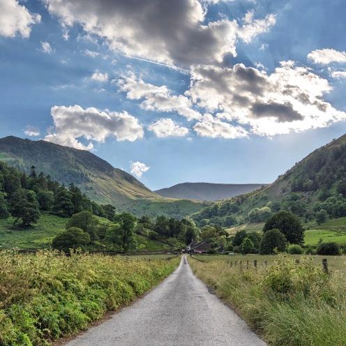 Road to farm and hills. Cumbria